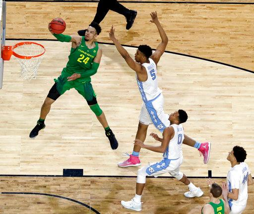 Oregon's Dillon Brooks (24) goes up for a basket against North Carolina's Tony Bradley (5) during the first half in the semifinals of the Final Four NCAA college basketball tournament, Saturday, April 1, 2017, in Glendale, Ariz. (AP Photo/David J. Phillip)