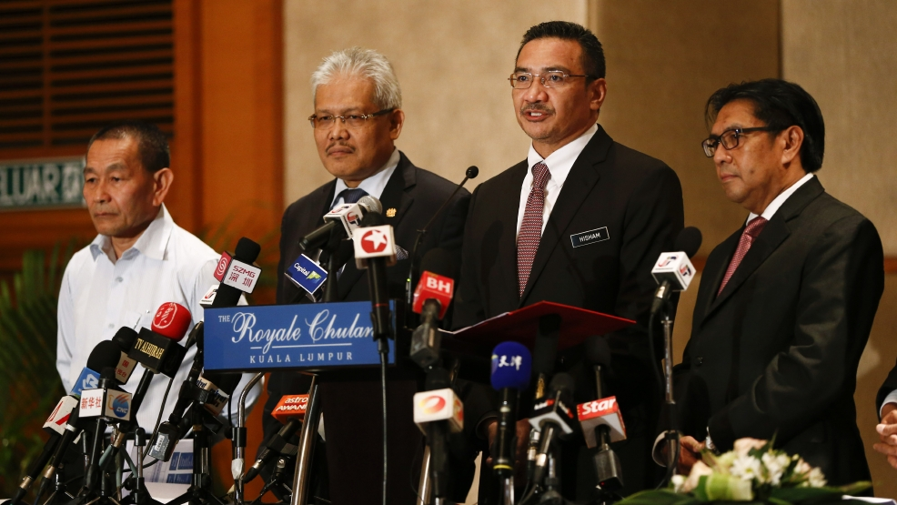 "Malaysia's Defense Minister and acting Transport Minister Hishammuddin Hussein, second right, speaks druing a press conference on the missing Malaysia Airlines MH370 at a hotel in Kuala Lumpur, Malaysia, Monday, April 7, 2014. Hishammuddin says he is ""cautiously hopeful"" that there will be positive developments in the next few days, ""if not hours,"" in the search for the missing airliner. They are, from left, Malaysia Airlines Group CEO Ahmad Jauhari Yahya, Deputy Minister of Foreign Affairs Hamzah Zainudin, Hishammuddin and Director general of the Malaysian Department of Civil Aviation Azharuddin Abdul Rahman. (AP Photo/Vincent Thian)"