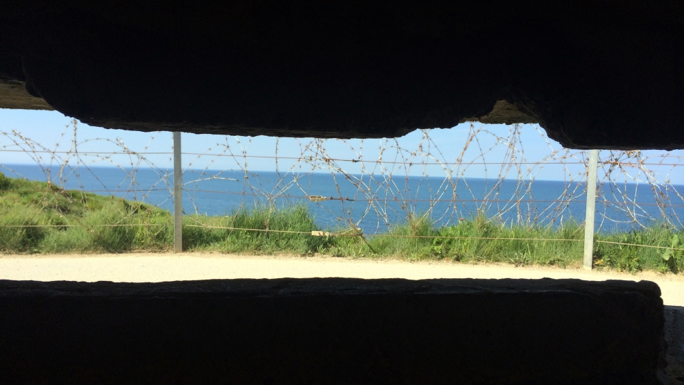 In this photo dated May 15, 2014, the Pointe du Hoc is seen from inside a German bunker in Cricqueville en Bessin, in Normandy, France. (AP Photo/Nicolas Garriga)
