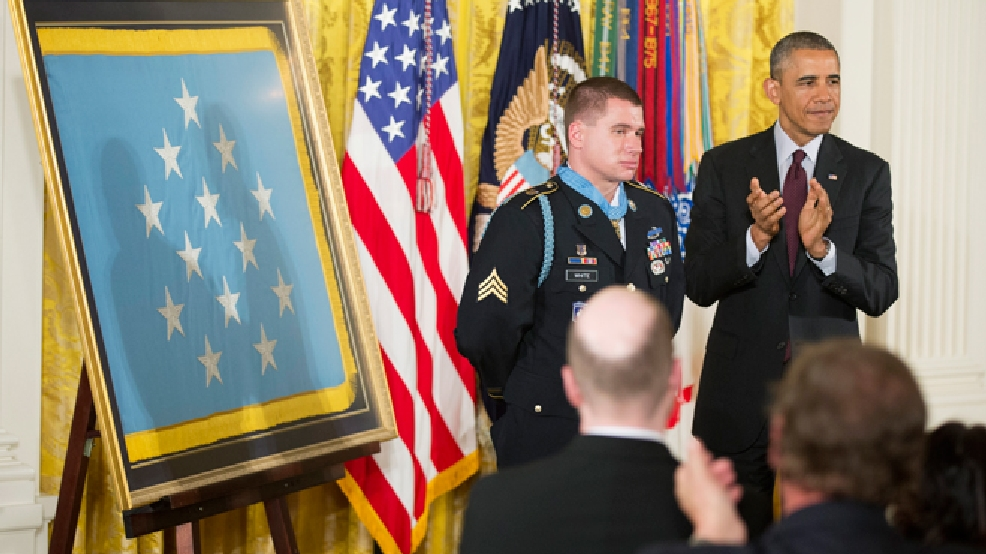 President Barack Obama applauds after awarding the Medal of Honor to former Army Sgt. Kyle J. White during a ceremony in the East Room of the White House in Washington, Tuesday, May 13, 2014. White is a former Army sergeant who saved a fellow soldier's life and helped secure the evacuation of other wounded Americans while under persistent fire during a 2007 ambush in Afghanistan. White is the seventh living recipient to be awarded the Medal of Honor for actions in Iraq or Afghanistan. (AP Photo)