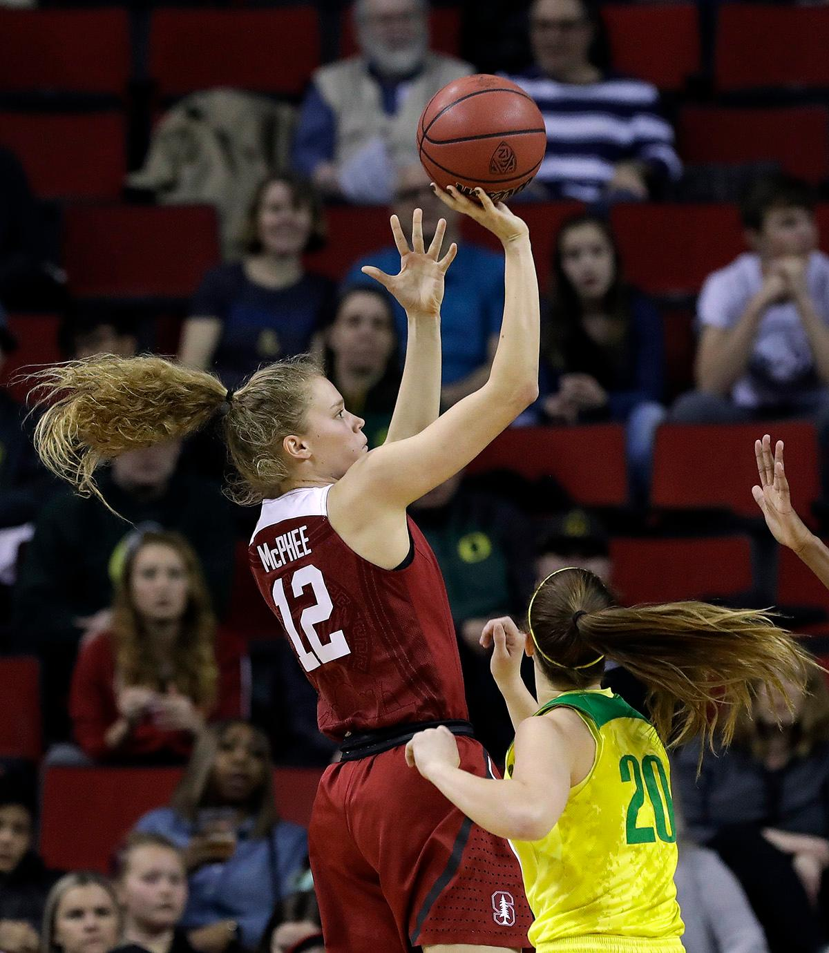 Stanford's Brittany McPhee (12) shoots over Oregon's Sabrina Ionescu during the first half of an NCAA college basketball game in the finals of the Pac-12 Conference women's tournament, Sunday, March 4, 2018, in Seattle. (AP Photo/Elaine Thompson)