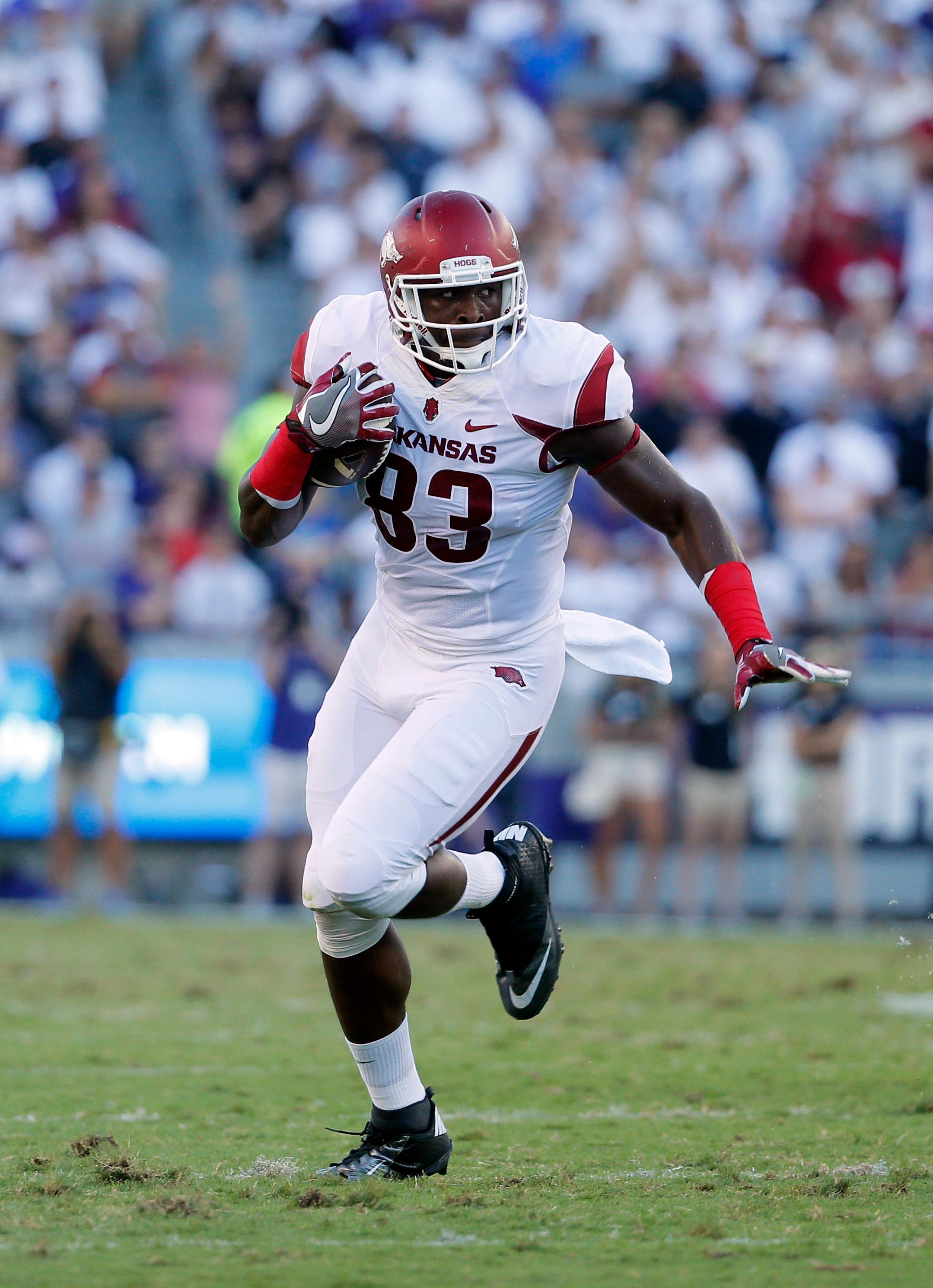Arkansas tight end Jeremy Sprinkle (83) was selected in the fifth round by the Redskins. Sprinkle runs after catching a pass from quarterback Austin Allen, rear, during an NCAA college football game against TCU on Saturday, Sept. 10, 2016, in Fort Worth, Texas. (AP File Photo/Tony Gutierrez)