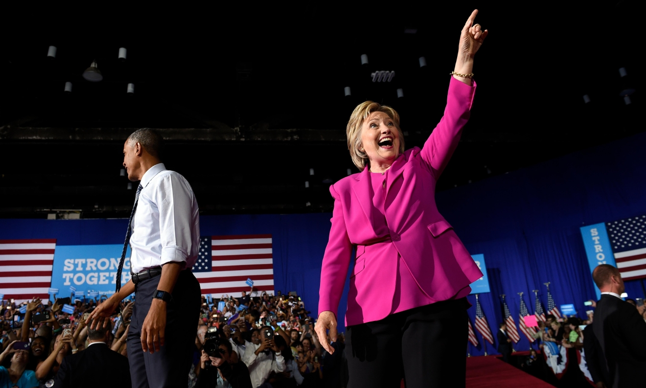 Democratic presidential candidate Hillary Clinton, accompanied by President Barack Obama, gestures as they arrive at a campaign event at the Charlotte Convention Center in Charlotte, N.C., Tuesday, July 5, 2016. Obama is spending the afternoon campaigning for Clinton. (AP Photo/Susan Walsh)