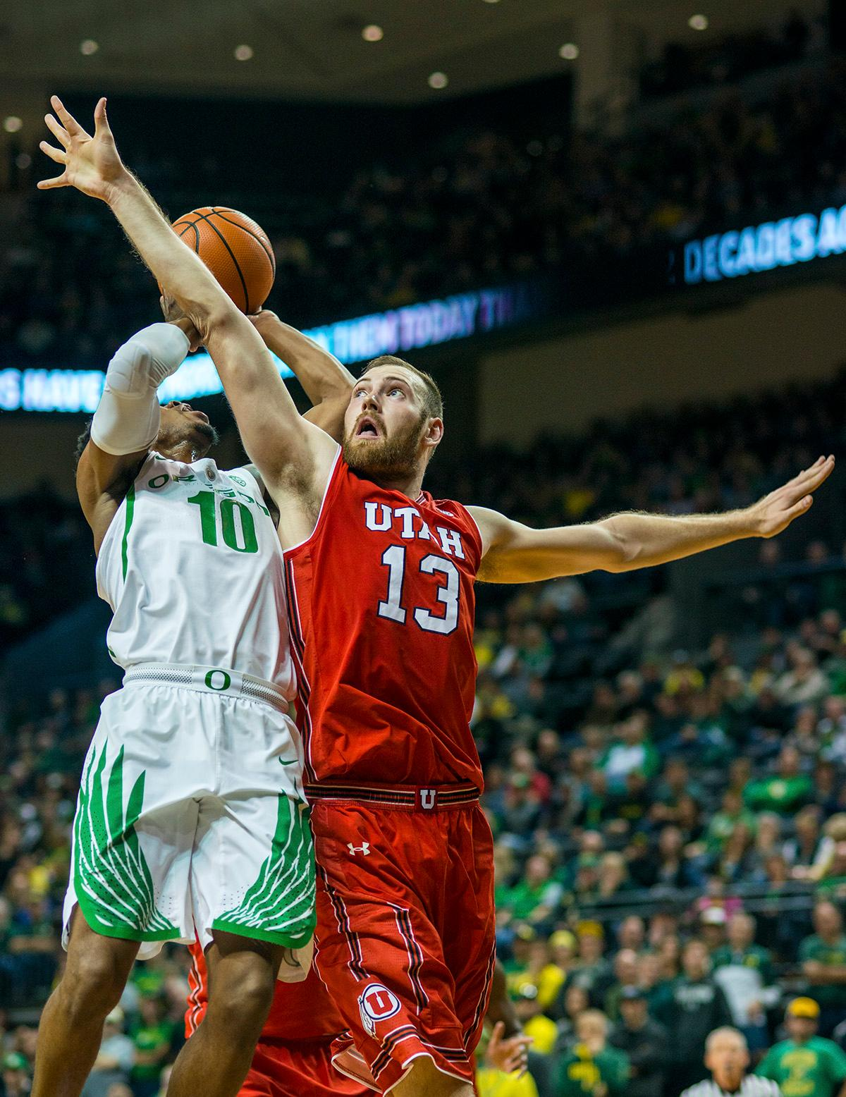 Oregon Ducks Victor Bailey Jr. (#10) aims for the basket as Utah Utes David Collette (#13) attempts to block him. The Utah Utes defeated the Oregon Ducks 66-56 on Friday night at Matthew Knight Arena. This is the first Pac-12 conference game loss at home for the Ducks since January of 2015. This also ended the five home game winning streak for the Ducks against the Utah Utes. Photo by Rhianna Gelhart, Oregon News Lab