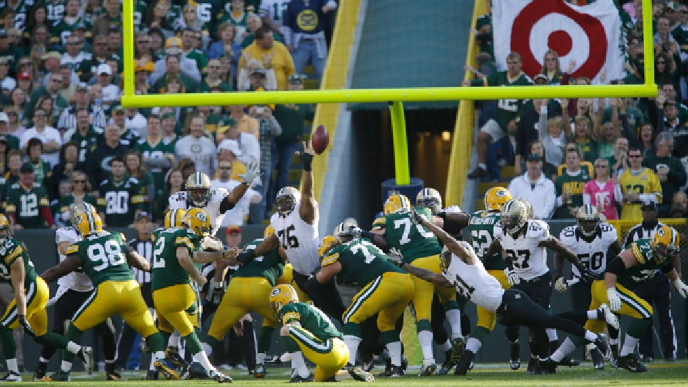 Green Bay Packers' Mason Crosby (2) kicks an extra point against New Orleans Saints in the first half of an NFL football game Sunday, Sept. 30, 2012 in Green Bay, Wis. (AP Photo/Jeffrey Phelps)