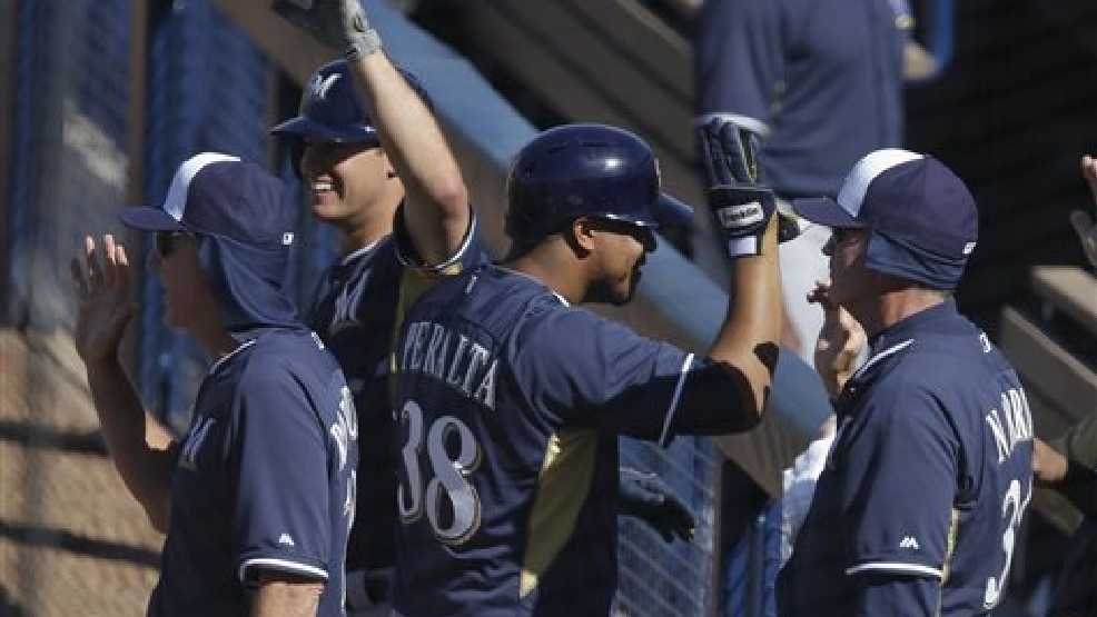 Milwaukee Brewers' Wily Peralta (38) is congratulated by teammates after hitting a two-run home run during the sixth inning of a spring exhibition baseball game against the Seattle Mariners, Wednesday, March 19, 2014, in Peoria, Ariz. (AP Photo/Darron Cummings)