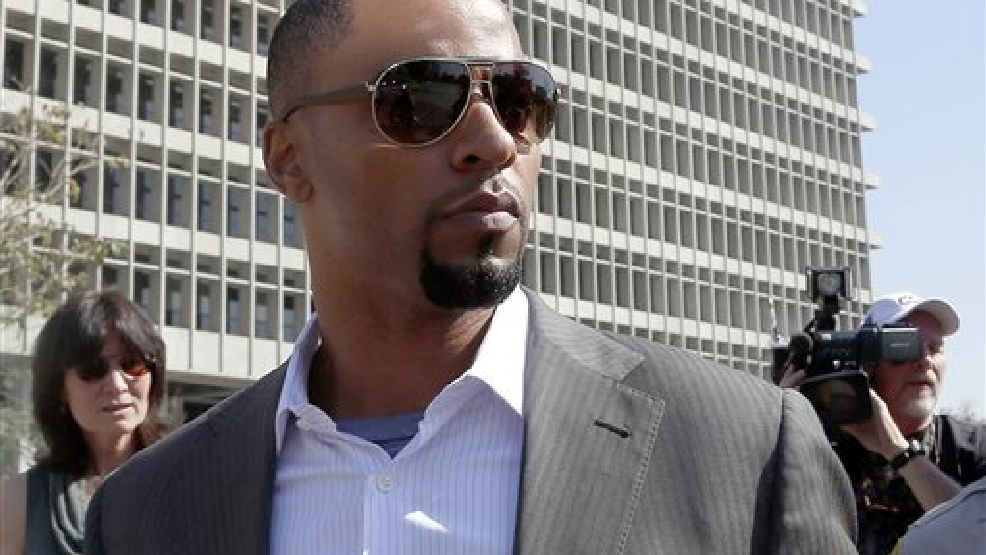 In this Feb. 14, 2014, file photo, former NFL football player Darren Sharper leaves a courthouse in Los Angeles. Sharper appeared in a Los Angeles court Wednesday, July 16, 2014, but the back-to-back hearings on sexual assault allegations he faces were postponed to Aug. 8. Wednesday's proceedings had been scheduled to set a date for a preliminary hearing of allegations that he drugged and raped two women he met at a West Hollywood nightclub. (AP Photo/Nick Ut, File)