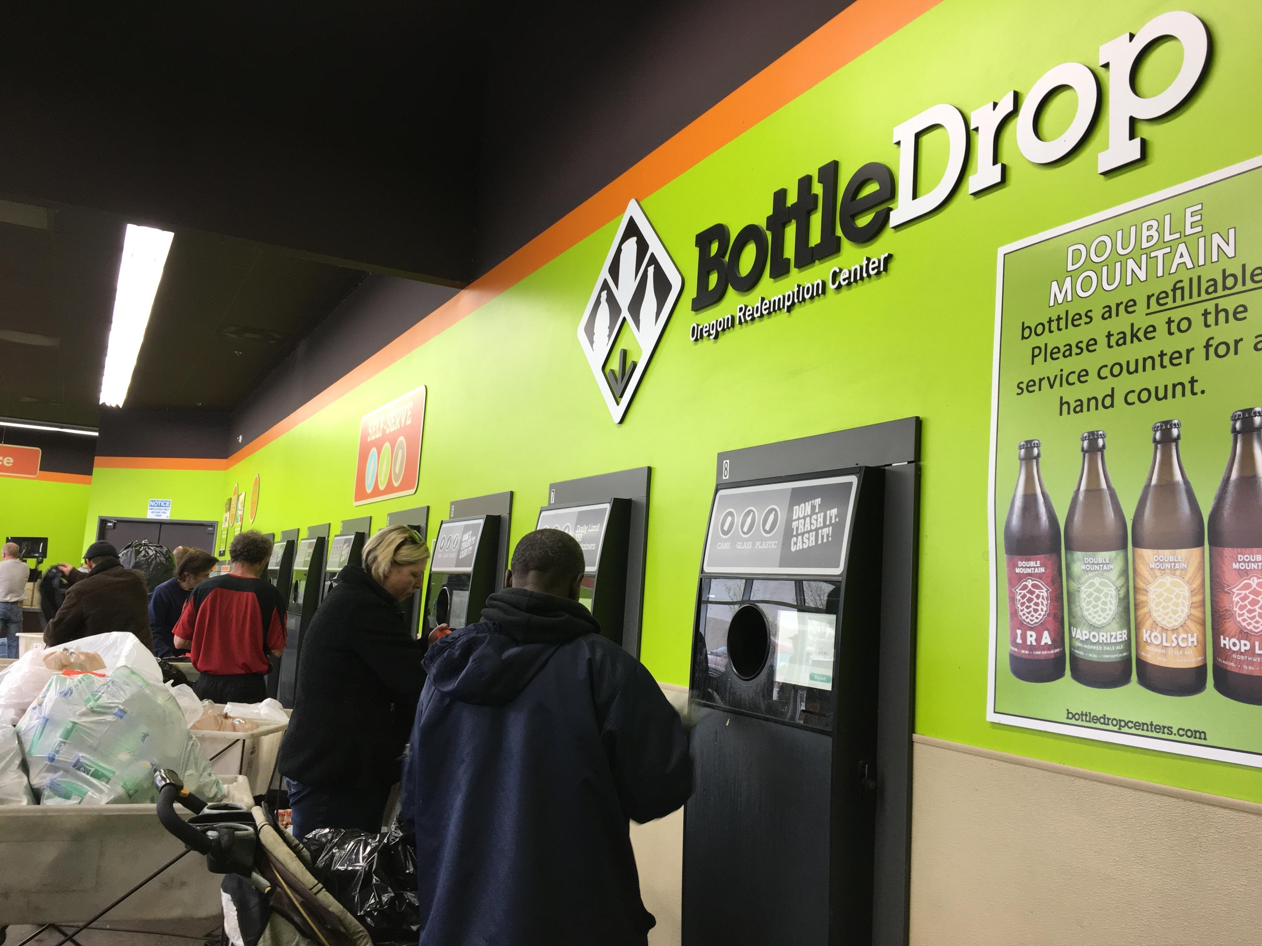Oregon residents formed steady lines at a BottleDrop recycling redemption center in Portland, Ore., on Saturday, April 1, 2016, the first day the refund rate for empty water bottles, beer bottles and soda cans jumped to 10 cents. Oregon was the first state in the nation to give 5-cent refunds for recycling used water bottles and soda cans more than 45 years ago. Now, in an effort to boost recycling, this eco-trailblazing state is doubling that refund. (AP Photo/Kristena Hansen).""