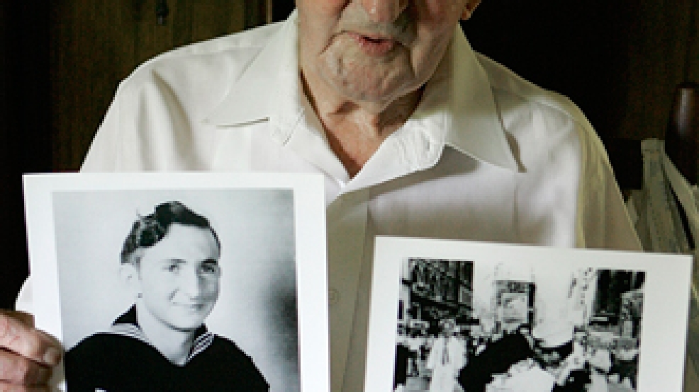 Glenn McDuffie holds a portrait of himself as a young man, left, and a copy of Alfred Eisenstaedt's iconic Life magazine shot of a sailor embracing a nurse in a white uniform, right, at his Houston home Tuesday, July 31, 2007. (AP Photo/Pat Sullivan)