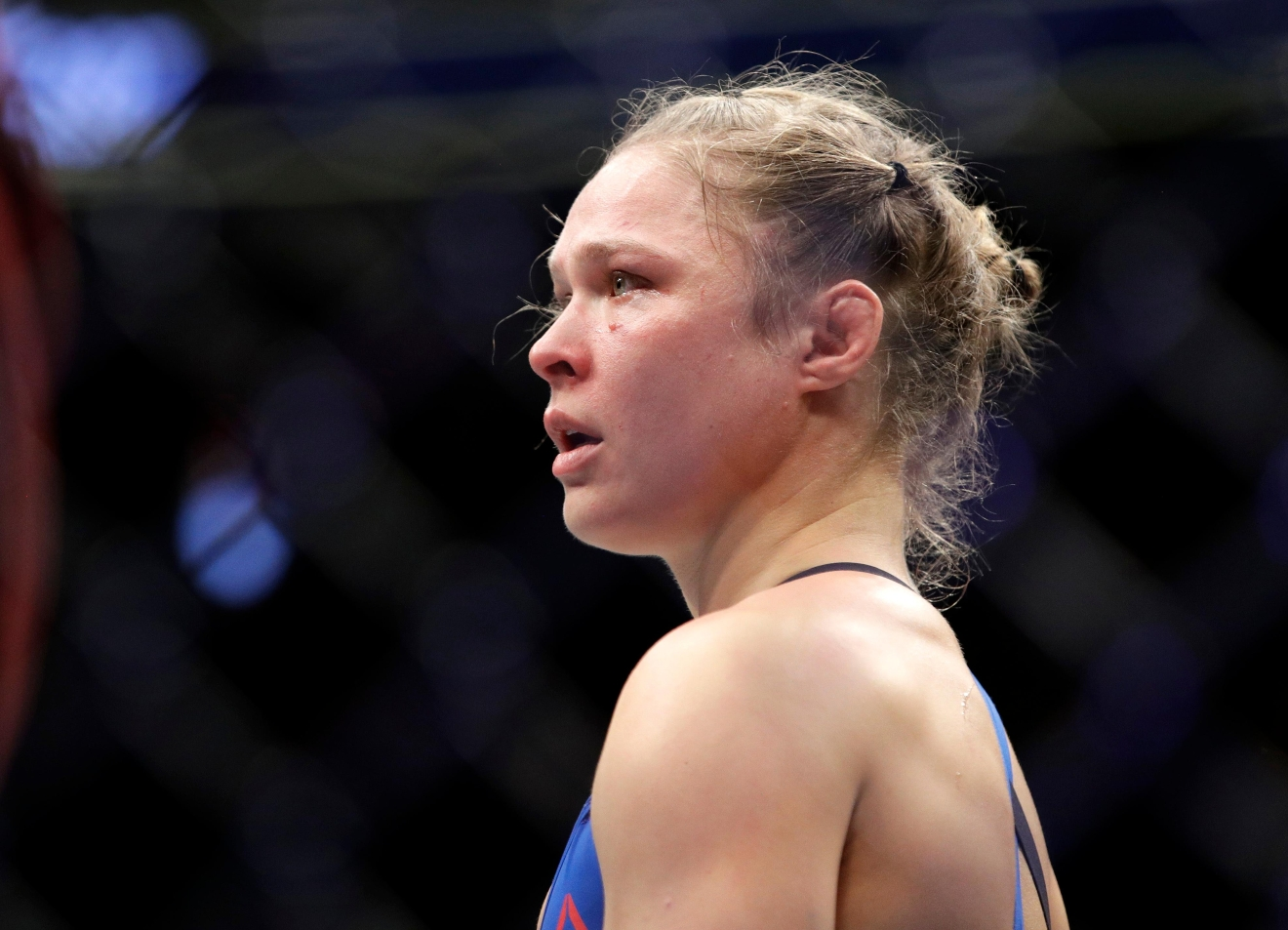 Ronda Rousey stands in the cage after Amanda Nunes forced a stoppage in the first round of their women's bantamweight championship mixed martial arts bout at UFC 207, Friday, Dec. 30, 2016, in Las Vegas. (AP Photo/John Locher)