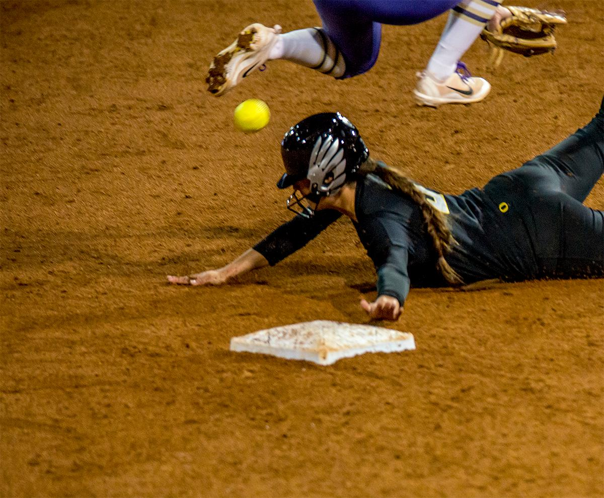 The Duck's Nikie Udria (#3) slides into second on a steal. In Game Two of a three-game series, the University of Oregon Ducks softball team defeated the University of Washington Huskies 4-1 Friday night in Jane Sanders Stadium. Danica Mercado (#2), Alexis Mack (#10) and Mia Camuso (#7) all scored in the win, Mack twice. The Ducks play the Huskies for the tie breaker on Saturday with the first pitch at noon. Photo by August Frank, Oregon News Lab