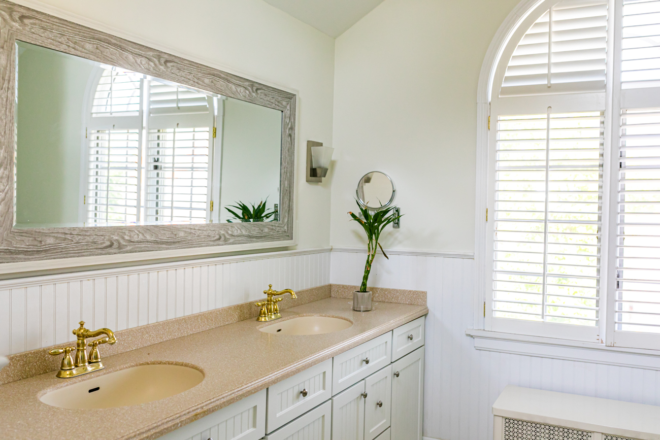 The master bathroom has his-and-hers sinks, a spacious shower and lots of light.{ }/ Image: Amy Spasoff // Published: 5.22.19