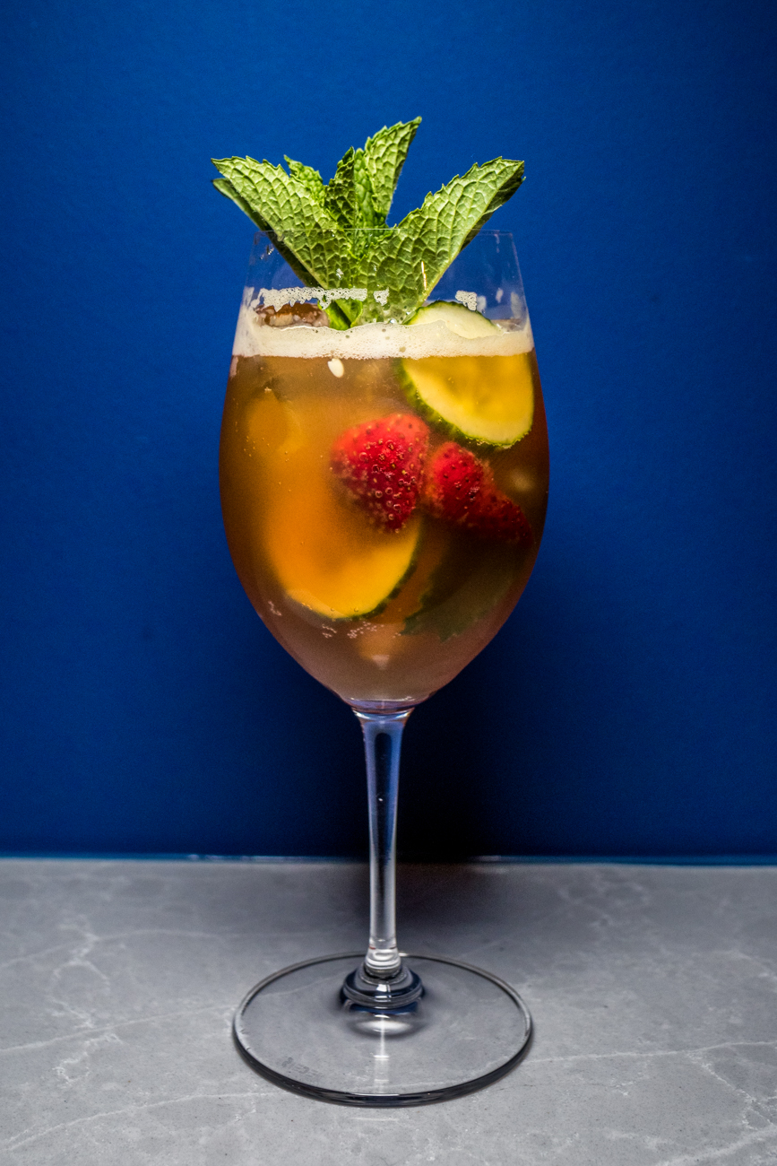 Pimms Cup: Pimm's No. 1, Barritt's Ginger Beer, lemon, orange wheel, cucumber wheel, and strawberry / Image: Catherine Viox // Published: 10.31.20