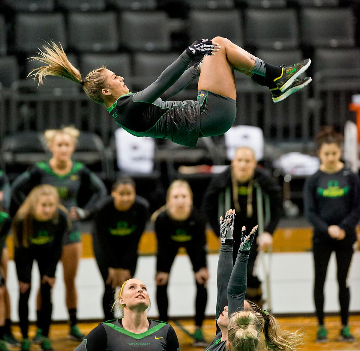 At their last home meet of the year and on Senior Night, the Ducks Acro and Tumbling Team defeated the Azusa Pacific Cougars, winning in all six categories: 38.70 to 37.20 in Compulsory; 29.35 to 28.60 in Acro; 29.40 to 29.35 in Pyramid; 29.35 to 28.95 in Toss; 57.525 to 66.15 in Tumbling; 103.75 to 98.03 in Team Routine; for an overall total of 288.08 to 277.28. The Ducks finished the season 6-1 and will next compete in the NCATA National Championship at Azusa, California, April 27-29. Photo by Dan Morrison, Oregon News Lab