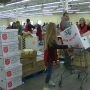 Dozens of families hustle to sort gifts for Salvation Army Angel Tree