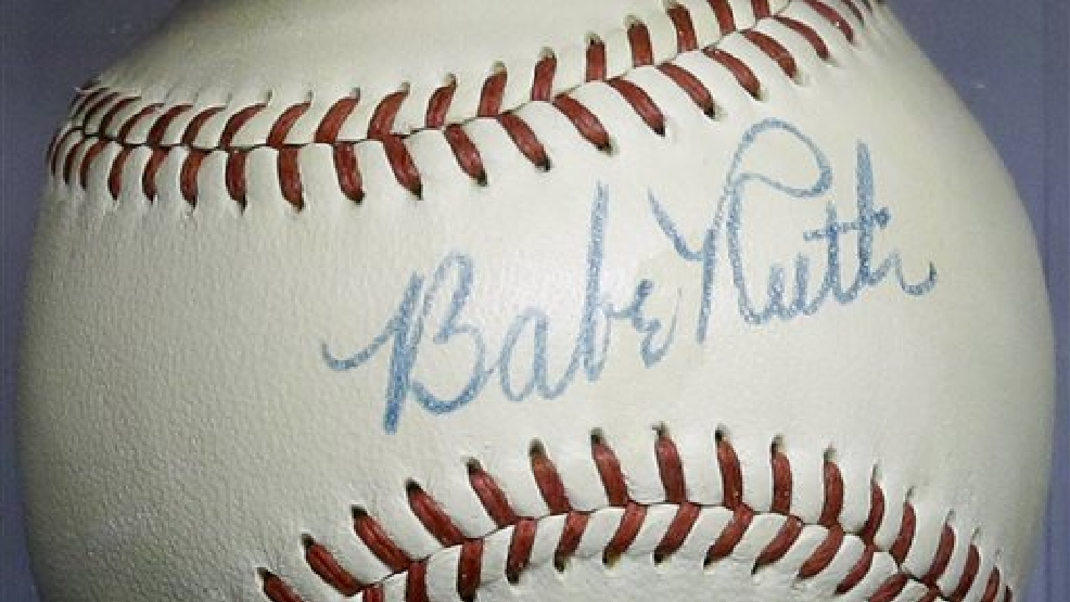 Babe Ruth's autograph is seen on a baseball that he signed in 1948, Wednesday, July 9, 2014, in Baltimore, during a media preview of sports memorabilia slated for auction to mark the 100th anniversary of Ruth's major league debut. The auction is scheduled to take place July 12, the day after the anniversary, and the organizers estimate that 125 items to be auctioned off could fetch as much as $10 million. (AP Photo/Patrick Semansky)