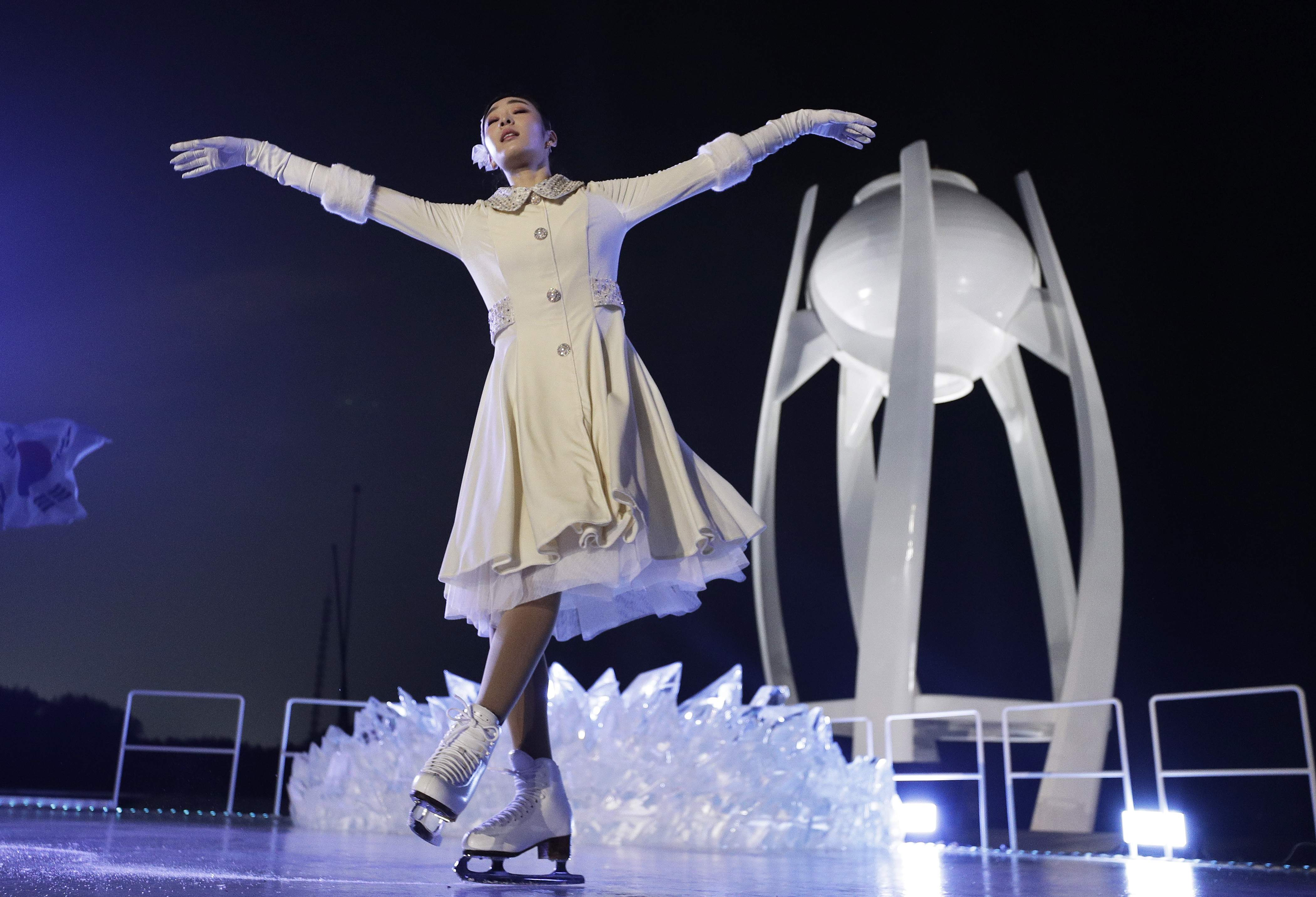 South Korean Olympic figure skating champion Yuna Kim performs before lighting the Olympic flame during the opening ceremony of the 2018 Winter Olympics in Pyeongchang, South Korea, Friday, Feb. 9, 2018. (AP Photo/David J. Phillip,Pool)