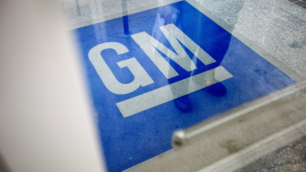 In this Thursday, Jan. 10, 2013 file photo, the logo for General Motors decorates the entrance at the site of a GM information technology center in Roswell, Ga. (AP Photo/David Goldman, File)