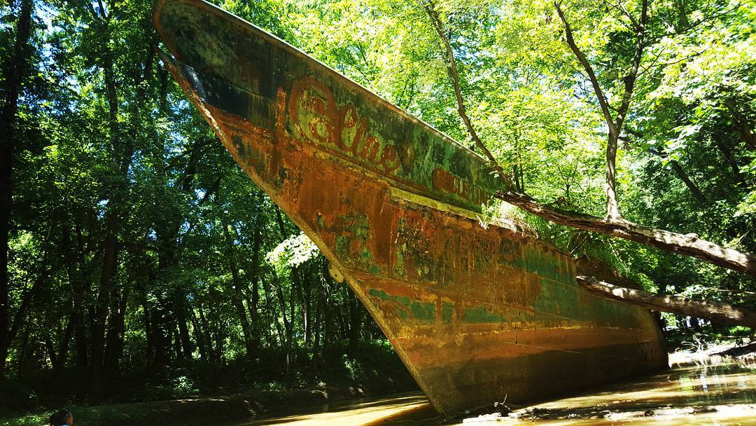 The Circle Line V was a ship that first launched in 1902, served numerous purposes, and subsequently came to rest on the banks of the Ohio River years later. For decades, the ship has been rusting beneath a canopy of trees, attracting visitors who want to see and photograph the hulking, metal boat. The ship sits on private property. / Image courtesy of Instagram user @alpage83 // Published: 8.4.18
