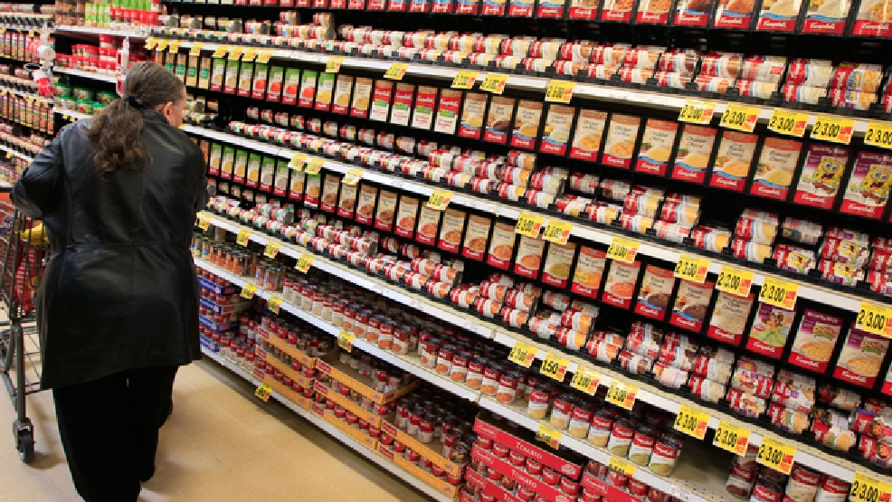 FILE - This Feb. 7, 2012 file photo shows a shopper walking down the canned soup aisle at a grocery store in Cincinnati. (AP Photo/Al Behrman, File)