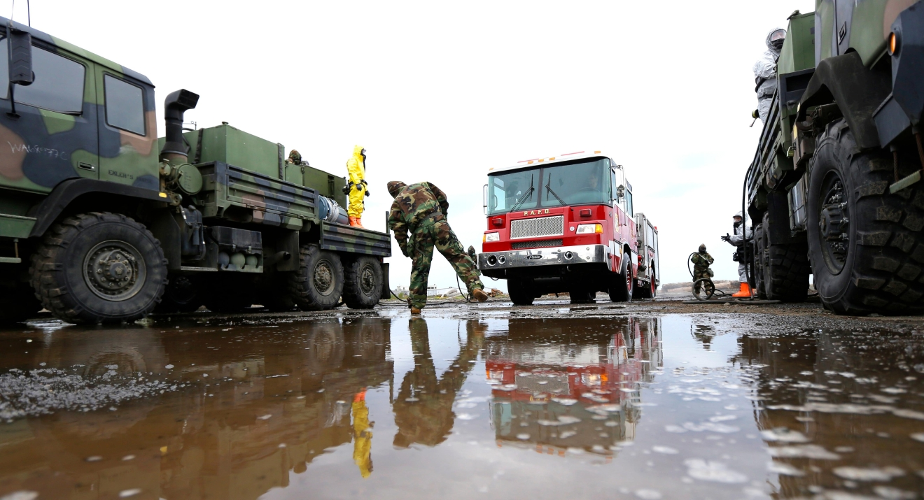Members of the Washington Army National Guard 792nd Chemical Company from Grandview, Wash., demonstrate how a fire truck would be decontaminated if it came in contact with polluted or hazardous substances stirred up by a tsunami, Wednesday, June 8, 2016, in Port Angeles, Wash. The exercise was part of a massive earthquake and tsunami drill called Cascadia Rising, that is built around the premise of a 9.0 magnitude earthquake 95 miles off of the coast of Oregon that results in a tsunami. (AP Photo/Ted S. Warren)