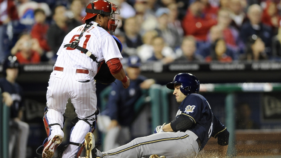 Milwaukee Brewers' Ryan Braun, right, slides past Philadelphia Phillies catcher Carlos Ruiz and scores on a hit by Aramis Ramirez during the fourth inning of a baseball game Thursday, April 10, 2014, in Philadelphia. (AP Photo/Michael Perez)