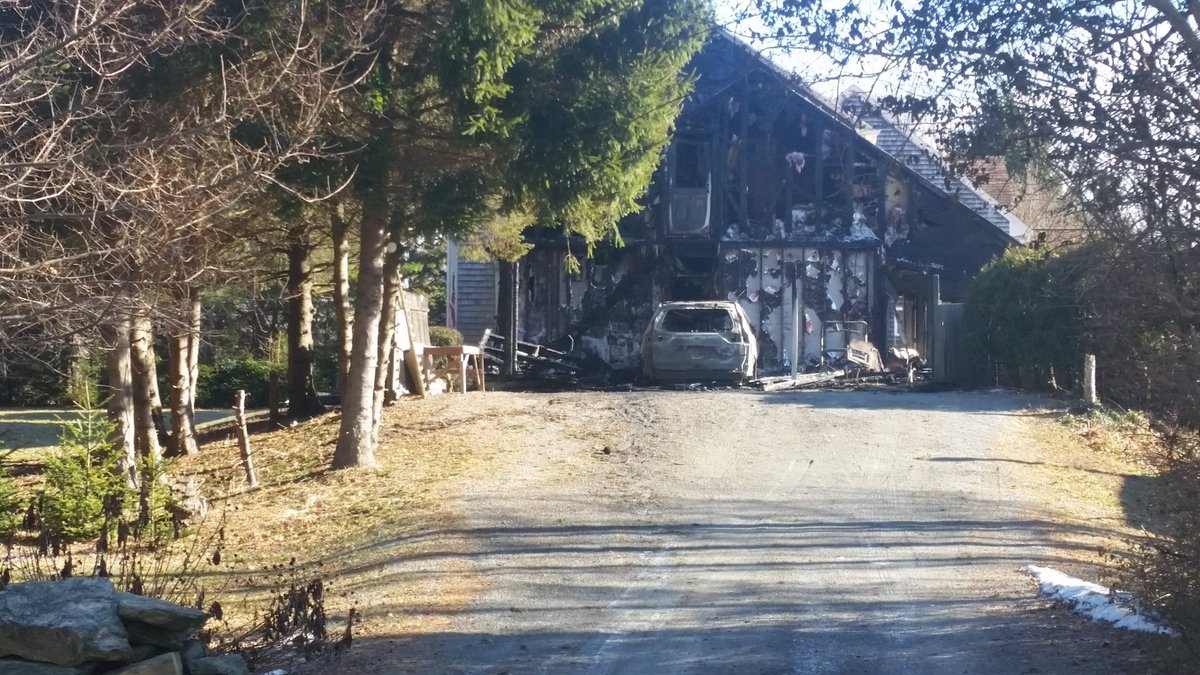 A fire destroyed a garage at a home on Old Farm Road in Little Compton, early Thursday, Jan. 18, 2018. (WJAR)
