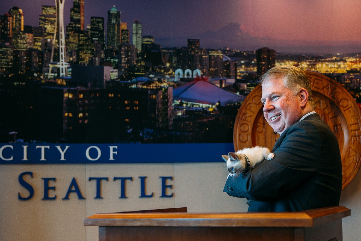 "Seattle Mayor Ed Murray has renamed City Hall to ""Kitty Hall"" for the day to highlight the Seattle Animal Shelter's foster care program and promote shelter cat adoptions. They set up an interactive tent out Kitty Hall where the public was invited to play and cuddle with the kittens, who later posed with the Mayor and City Council officials. SAS currently has more than 200 cats and kittens available for adoption. (Image: Joshua Lewis / Seattle Refined)"
