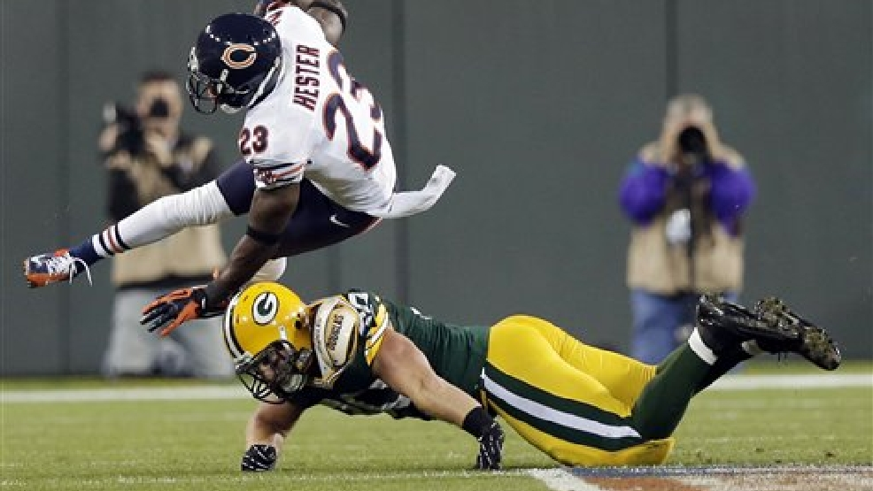 Chicago Bears' Devin Hester (23) is tackled by Green Bay Packers' John Kuhn on a punt return during the second half of an NFL football game Thursday, Sept. 13, 2012, in Green Bay, Wis. (AP Photo/Morry Gash)