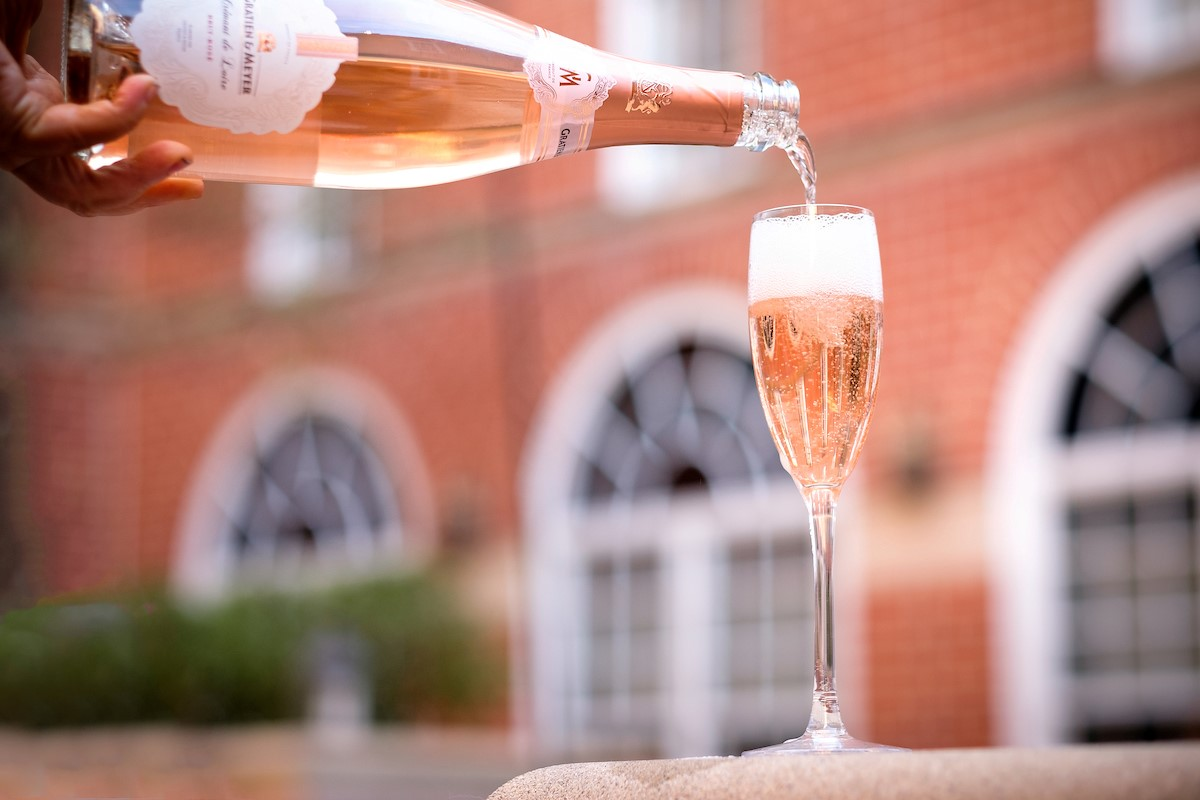 Brabo's new Summer Sparkle Program is launching with free sparkling cocktail tastings in the courtyard patio from 6-9 p.m. (Image: Courtesy Brabo)