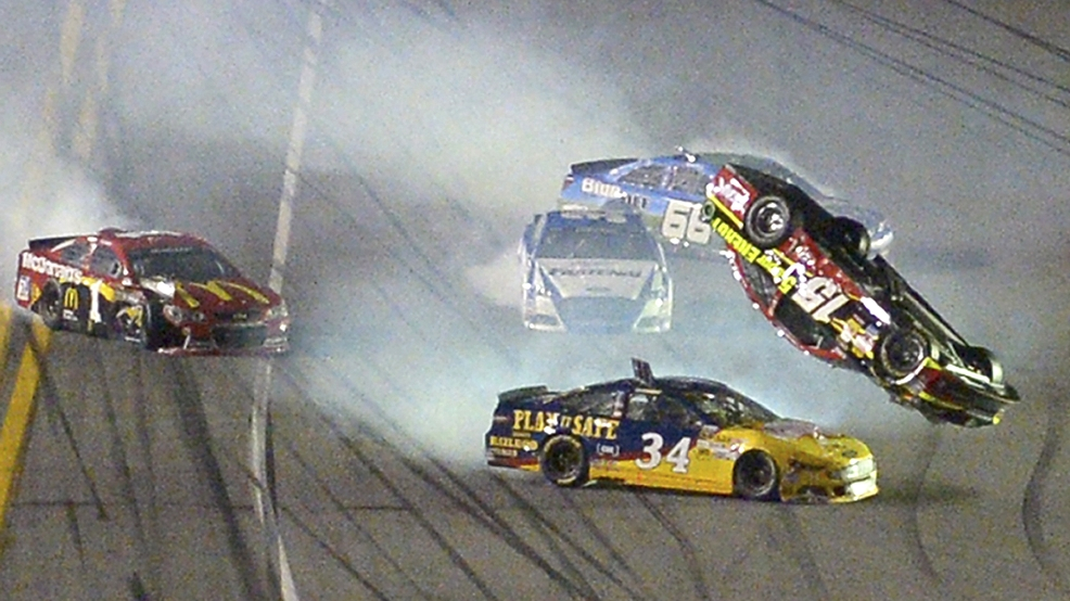 Clint Bowyer (15) flips over David Ragan (34) after a collision coming out of Turn 4 during the second of two NASCAR Sprint Cup qualifying auto races at Daytona International Speedway in Daytona Beach, Fla., Thursday, Feb. 20, 2014. (AP Photo/Phelan M. Ebenhack)