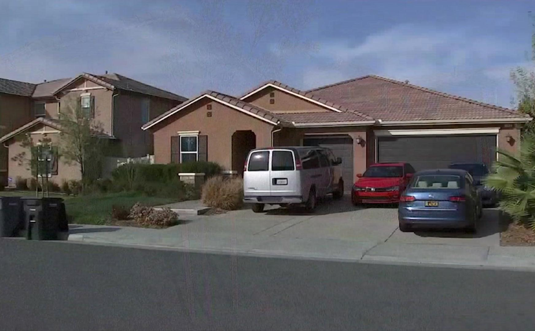 In this grab taken from video provided by KABC-TV on Tuesday, Jan. 16, 2018, the exterior of the home where police arrested a couple accused of holding their 13 children captive, in Perris, east of Los Angeles. Authorities say an emaciated teenager led deputies to a California home where her 12 brothers and sisters were locked up in filthy conditions, with some of them malnourished and chained to beds. (KABC-TV via AP)