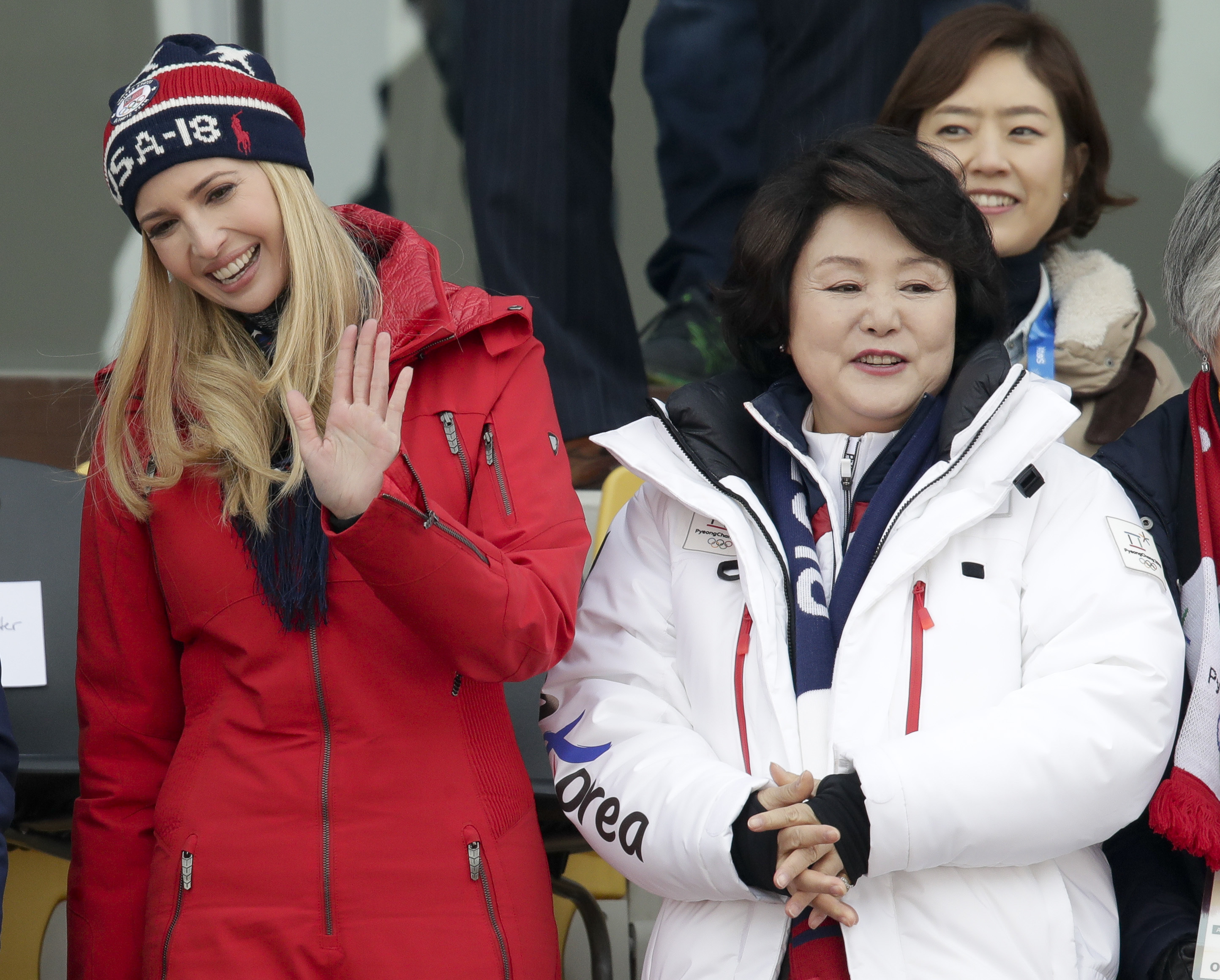Ivanka Trump, left, waves with Kim Jung-sook, wife of the South Korean President during the men's Big Air snowboard competition at the 2018 Winter Olympics in Pyeongchang, South Korea, Saturday, Feb. 24, 2018. (AP Photo/Dmitri Lovetsky)