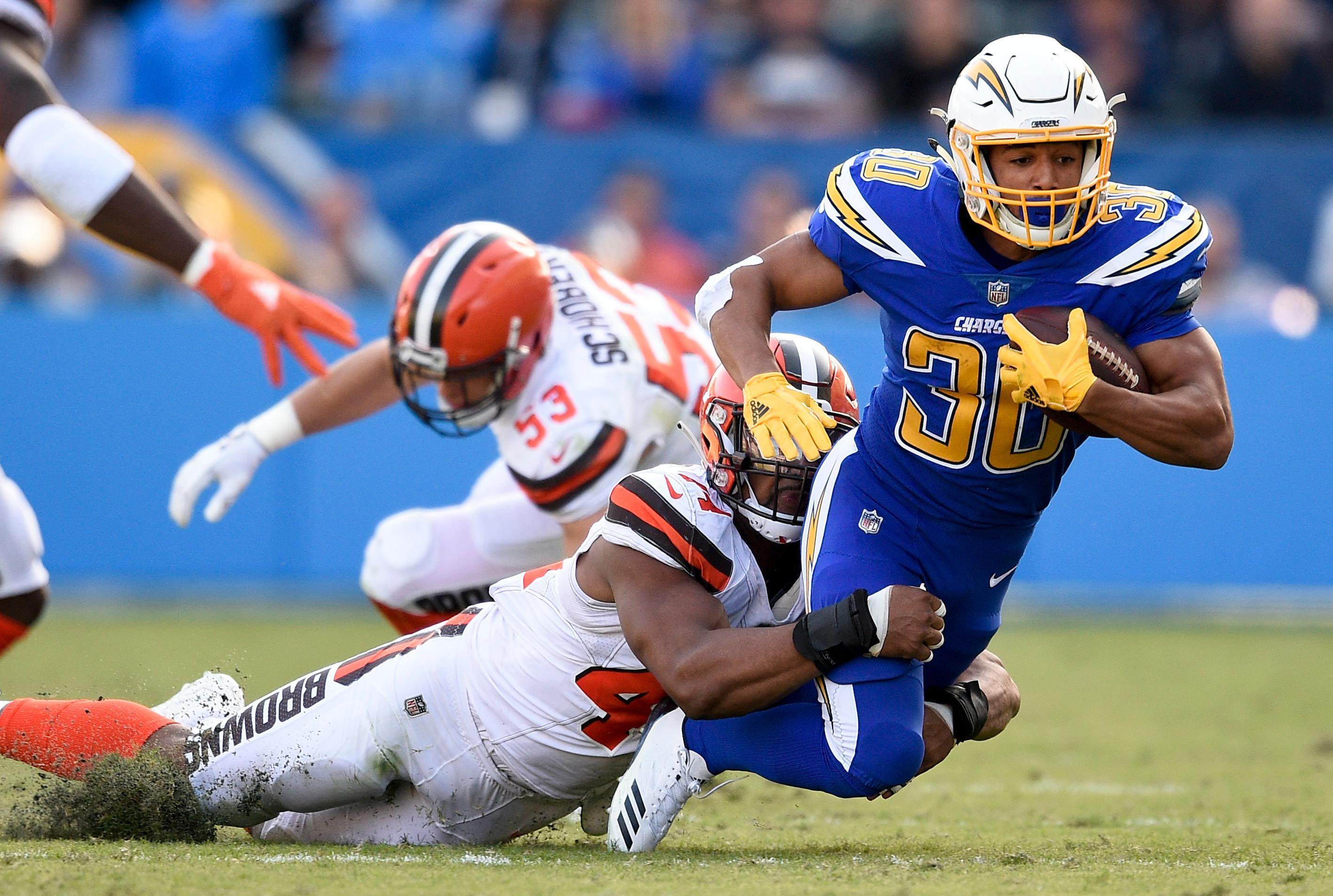 Los Angeles Chargers running back Austin Ekeler, right, is tackled by Cleveland Browns defensive end Nate Orchard during the first half of an NFL football game Sunday, Dec. 3, 2017, in Carson, Calif. (AP Photo/Kelvin Kuo)