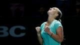 Cut above: Kuznetsova resorts to scissors to beat Radwanska