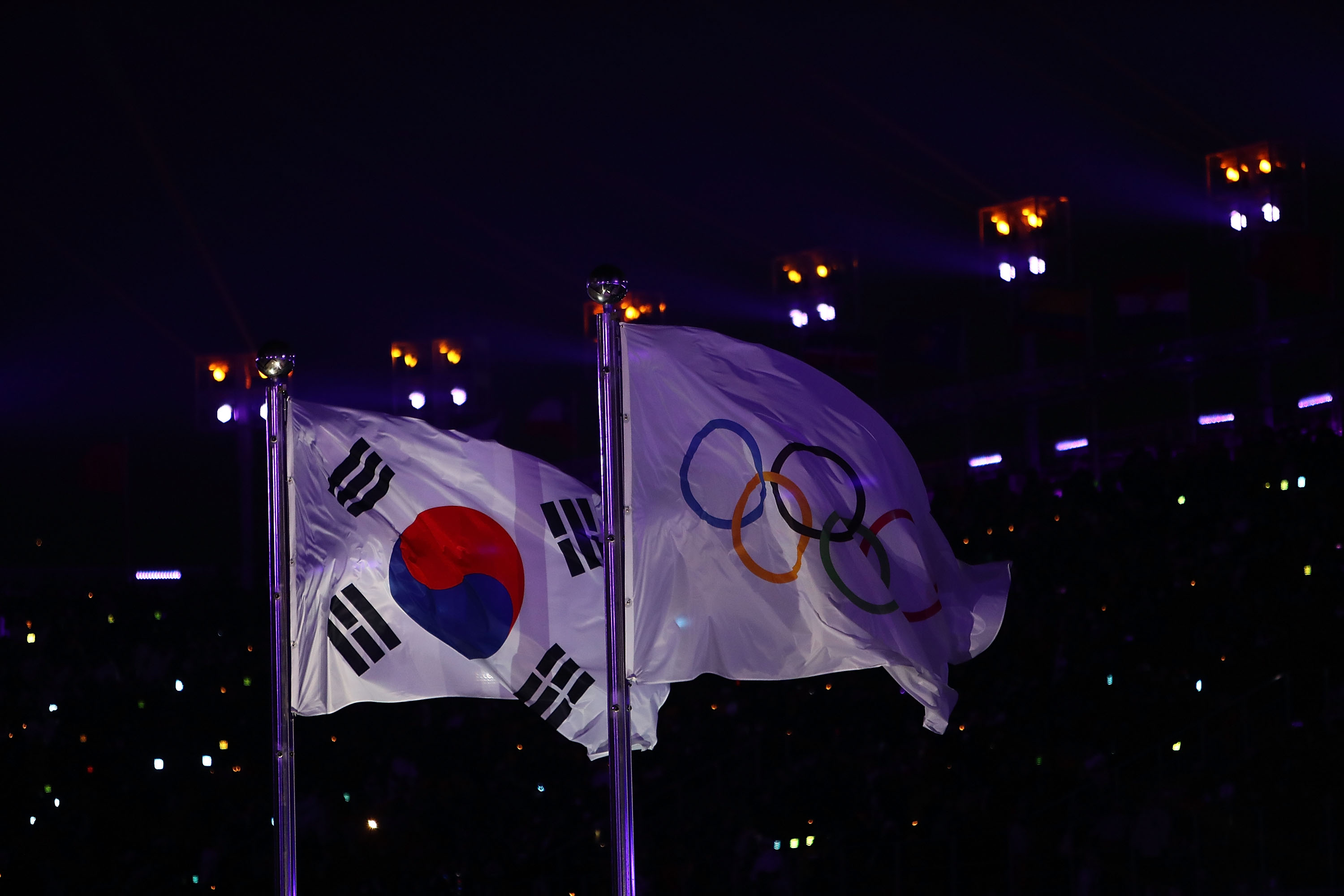 PYEONGCHANG-GUN, SOUTH KOREA - FEBRUARY 09:  The Olympic and South Korean flags fly during the Opening Ceremony of the PyeongChang 2018 Winter Olympic Games at PyeongChang Olympic Stadium on February 9, 2018 in Pyeongchang-gun, South Korea.  fee liable image, copyright © ATP  Amin JAMALI  XXIII. OLYMPIC WINTER GAMES PYEONGCHANG 2018: OPENING CEREMONY,  PyeongChang, Korea, Winter Olympics; PyeongChang Olympic Stadium, on 9. February 2018, fee liable image, copyright © ATP / Amin JAMALI  Featuring: The Olympic and South Korean flags fly Where: Pyeongchang, Gangwon Province, South Korea When: 09 Feb 2018 Credit: ATP/WENN.com  **Not available for publication in Germany or France. No Contact Music.**