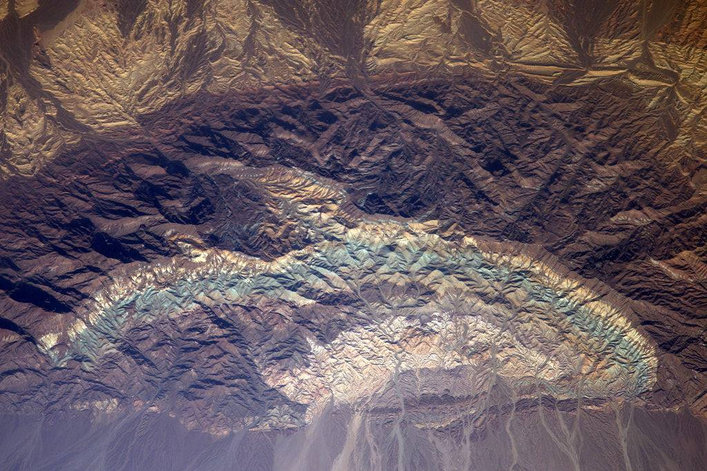 These rock formations in Iran look just like multi-coloured crumpled paper (Photo & Caption: Thomas Pesquet // NASA)