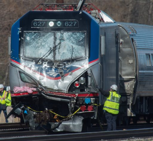 National Transportation Safety Board staffers inspect the engine of Amtrak Train 89 which hit a construction vehicle on the tracks and derailed in Chester, Pa., Sunday, April 3, 2016. The train was heading from New York to Savannah, Ga. (Clem Murray/The Philadelphia Inquirer via AP)