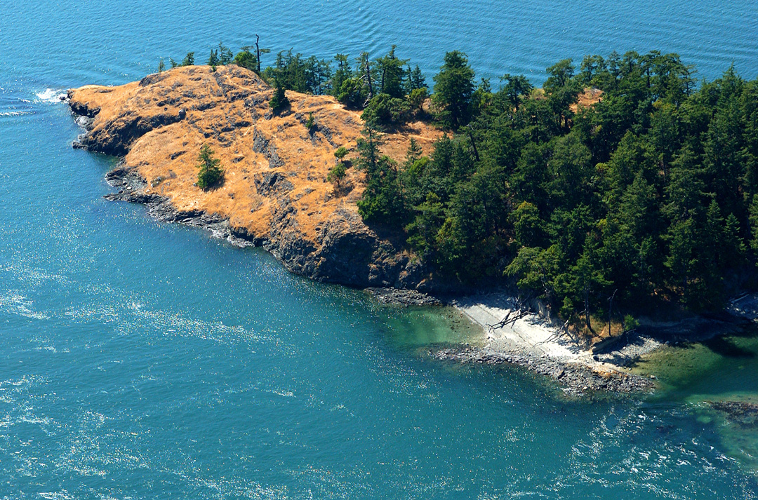 Ram Island is located about 9 miles east of Anacortes Washington on Lopez Pass between Lopez and Decatur Islands, and is 8.8 acres according to the San Juan County Assessor. It's for sale with Kent Meeker Inc. for $3.5 million. (Image: Robert Demar)