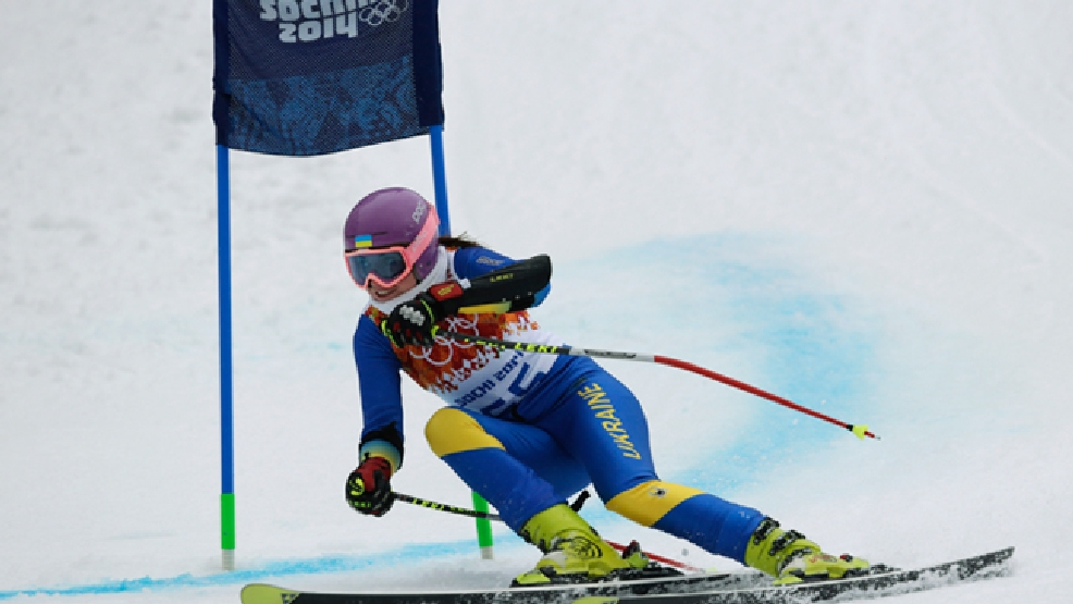 In this Saturday, Feb. 15, 2014 photo, Ukraine's Bogdana Matsotska passes a gate in the women's super-G at the Sochi 2014 Winter Olympics in Krasnaya Polyana, Russia. The International Olympic Committee said on Thursday, Feb. 20, that Matsotska has left the Olympics in response to the violence in her country. (AP Photo/Charles Krupa)