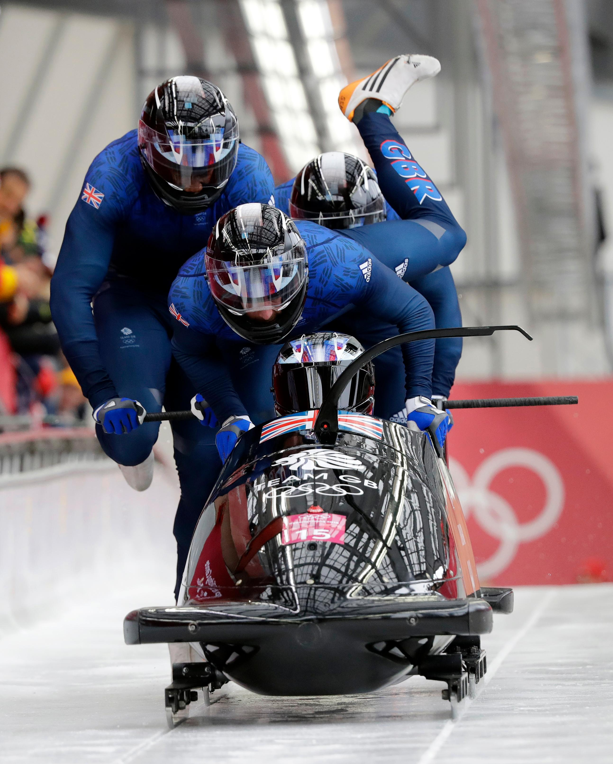Driver Lamin Deen, Andrew Matthews, Toby Olubi and Ben Simons of Britain start their heat on the first day of four-man bobsled competition at the 2018 Winter Olympics in Pyeongchang, South Korea, Saturday, Feb. 24, 2018. (AP Photo/Wong Maye-E)