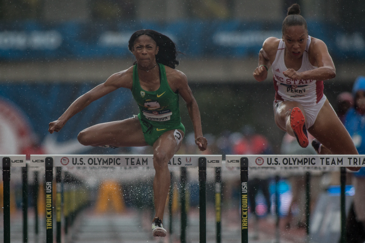Alaysha Johnson of Oregon battles the rain as she clears the final hurdle. Photo by Dillon Vibes