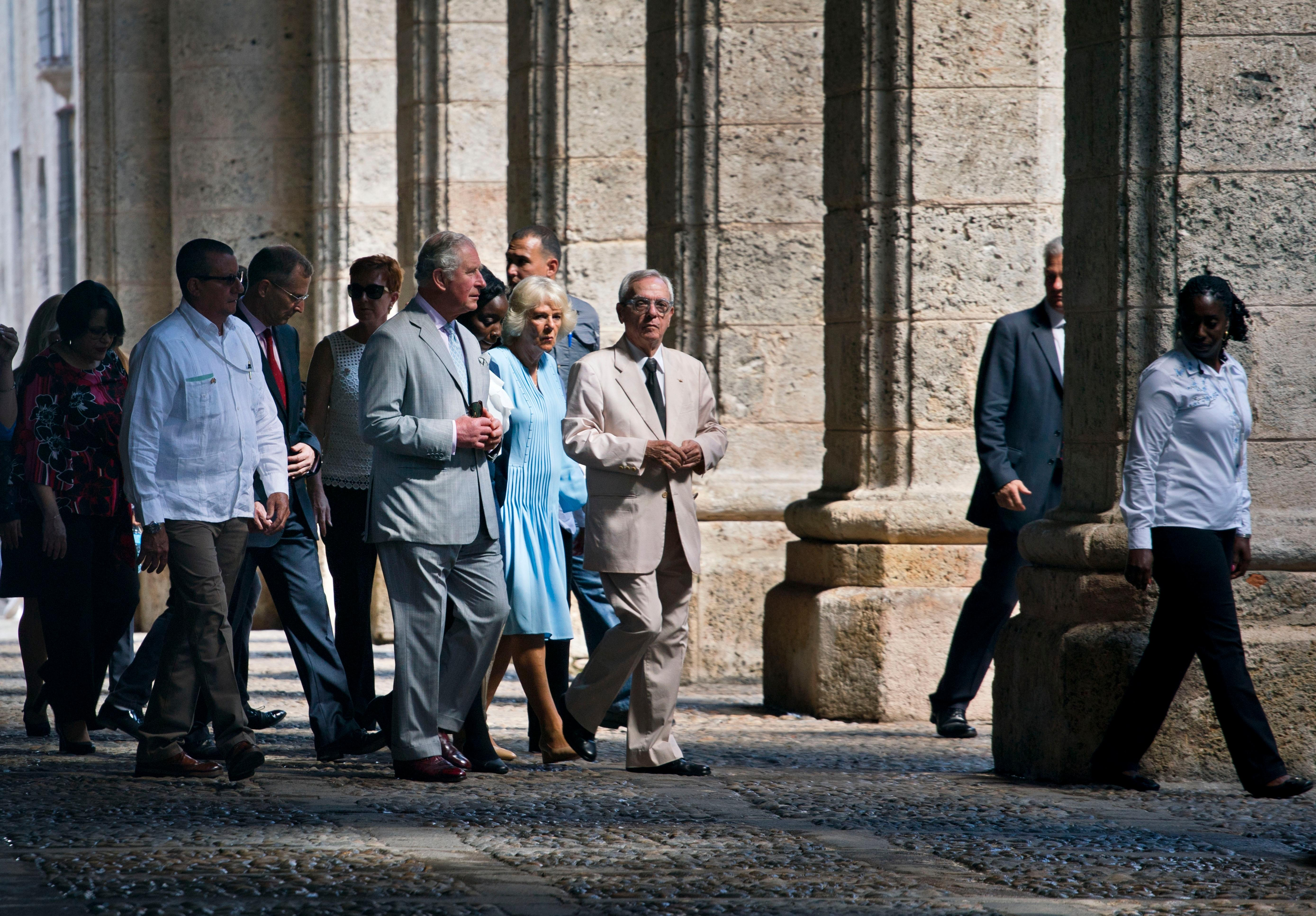 Britain's Prince Charles, the Prince of Wales, front left, and his wife Camilla, Duchess of Cornwall, take a guided tour led by City Historian Eusebio Leal, center, during their trip to Havana, Cuba, Monday, March 25, 2019. (AP Photo/Ramon Espinosa)