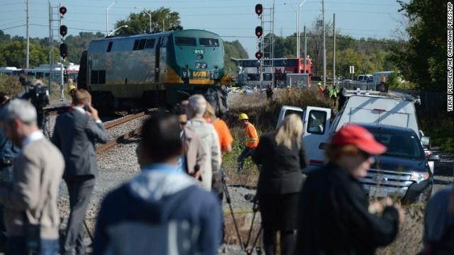 Members of the media watch as emergency crews respond to the crash on September 18.