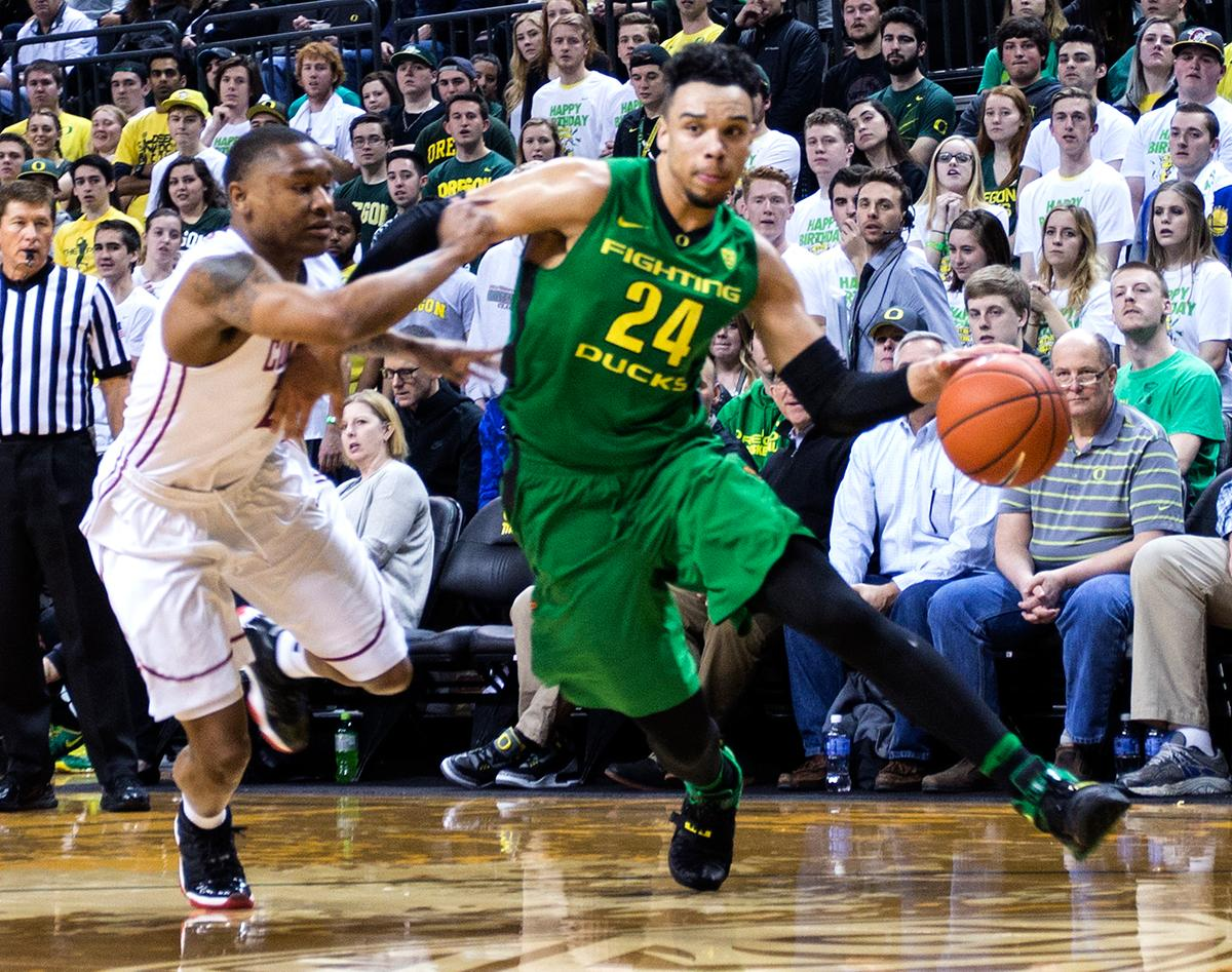 Oregon Ducks' Dillon Brooks (#24) drives toward the basket during the game against the Washington State Cougars. Brooks scored 17 points for Oregon. The Ducks beat the Cougars 76-62. Kianna Cabuco, Oregon News Lab