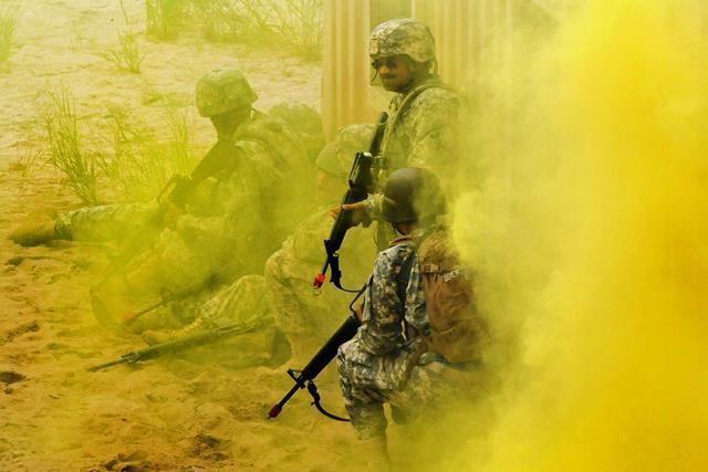 U.S. soldiers react to an improvised explosive device during training on Joint Base McGuire-Dix-Lakehurst, N.J., Aug. 10, 2013.
