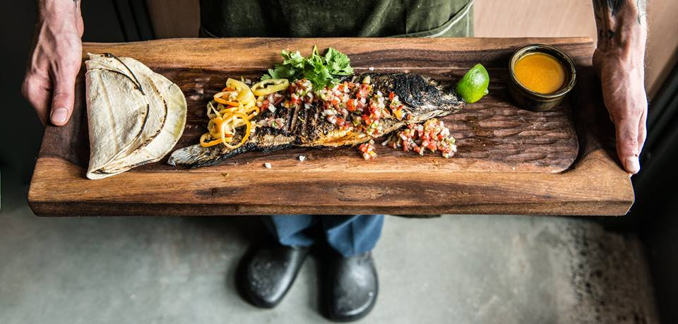 Quality Athletics' version of fish tacos; branzino, pickled peppers, pico de gallo, cilantro, and lime. (Image: Sarah Flotard)