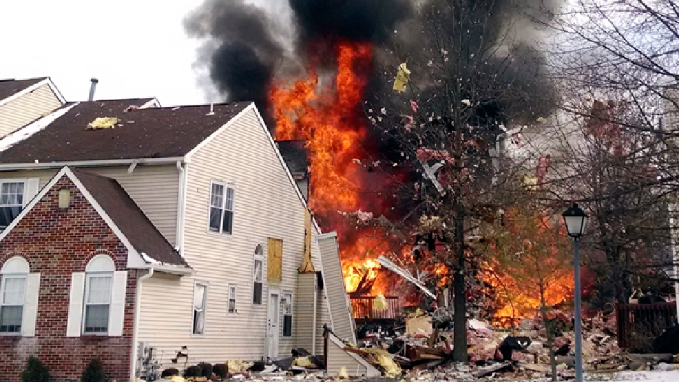 "In this image provided by Josh Forst, flames and smoke shoot up after an explosion at a townhouse complex Tuesday, March 4, 2014, in Ewing, N.J. A gas line damaged by a contractor exploded ""like a bomb"" while utility crews worked to repair it Tuesday at the complex, injuring at least seven people while several homes were destroyed or damaged. (AP Photo/Josh Forst)"