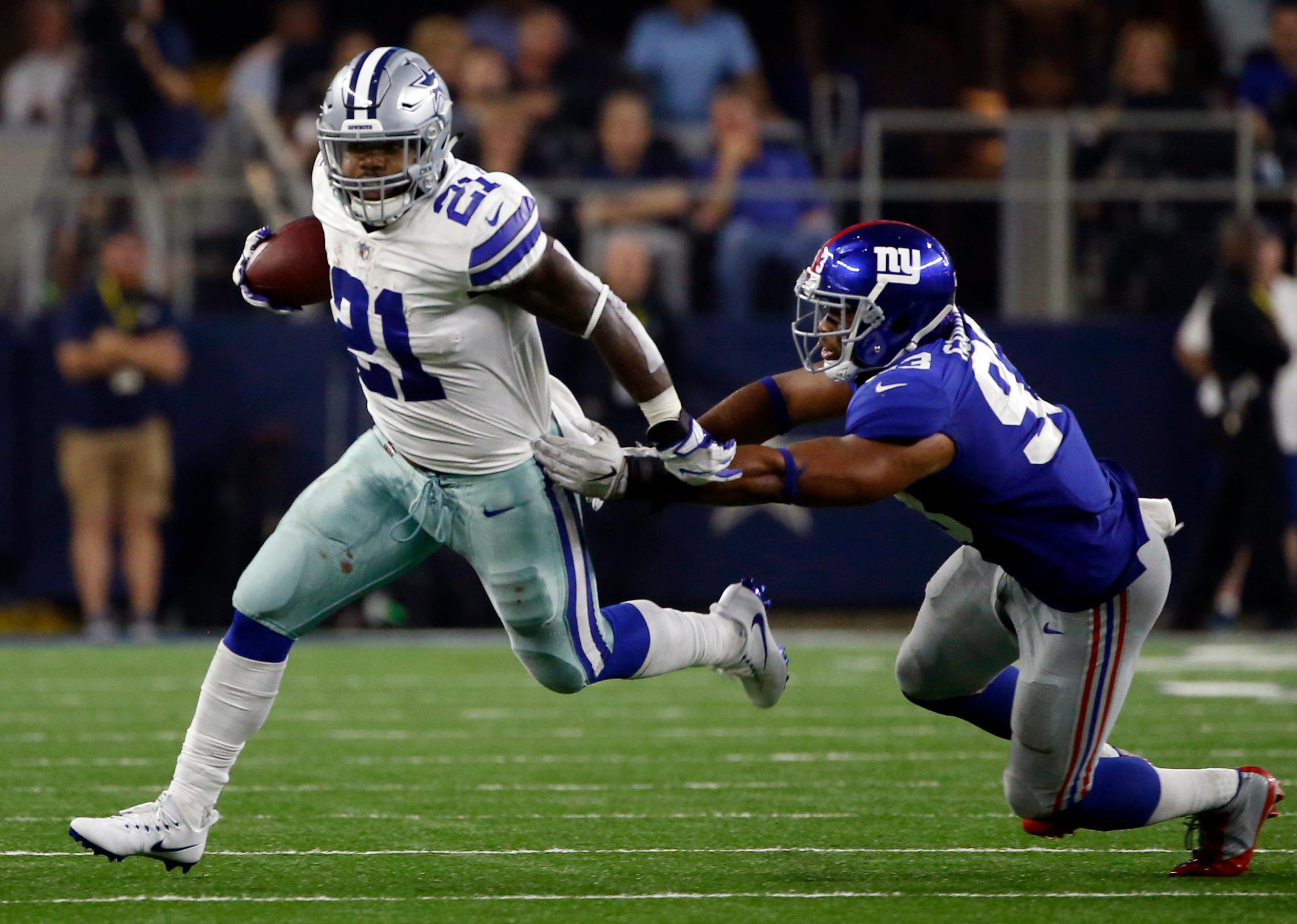 ... Giants Jersey Womens Limited Nike NFL 2016 Salute Dallas Cowboys  running back Ezekiel Elliott (21) escapes a tackle attempt by New York  Jasons 2016 B.J. ... 28272573a