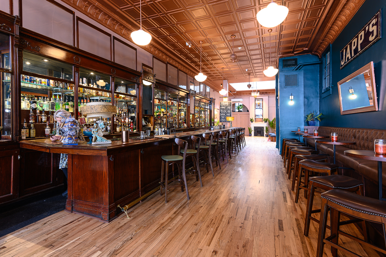 Among the most radical changes made was the removal of the large pergola that enclosed tables and chairs on the right side of the bar. Today, Japp's boasts an elevated, custom-made banquette free of the low roof and sightline-disrupting columns from before. / Image: Phil Armstrong, Cincinnati Refined // Published: 10.25.19